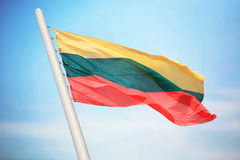 Flag of Lithuania. The Lithuanian flag against the background of the blue sky stock photos