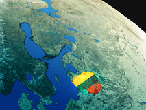 Flag of Lithuania from space. Lithuania with embedded national flag as if seen from Earth's orbit in space. 3D illustration with highly detailed realistic planet Stock Photo