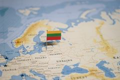 The Flag of lithuania in the world map stock image