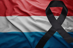Flag of luxembourg with black mourning ribbon. Waving national flag of luxembourg with black mourning ribbon Stock Photography