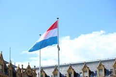 Flag of Luxembourg. On a blue backgroung stock photos
