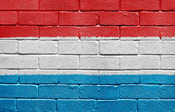 Flag of Luxembourg on brick wall Stock Photo