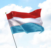 Flag of Luxembourg. Raised Up in The Sky Stock Photos