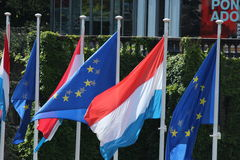 Flag of Luxembourg and UE. Flag of Luxembourg close to the Flag of European Union stock photography