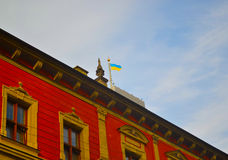 Flag. Lviv city center's renowned City Hall Stock Images