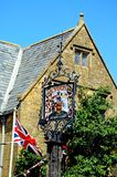 Flag and Lygon Arms sign, Broadway. Royalty Free Stock Photo