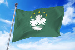 Flag of Macao developing against a clear blue sky Stock Image