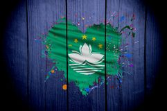 Flag of Macau in the shape of heart on a dark background royalty free stock image