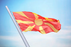 Flag of Macedonia. The Macedonian flag against the background of the blue sky stock photography