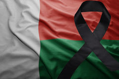 Flag of madagascar with black mourning ribbon Stock Photography