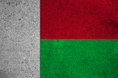 Flag Madagascar. Madagascar flag on an old grunge background Royalty Free Stock Images