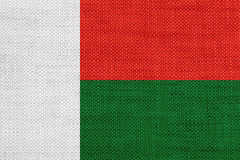 Flag of Madagascar on old linen. Colorful and crisp image of flag of Madagascar on old linen Royalty Free Stock Photography
