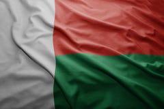 Flag of Madagascar. Waving colorful national Madagascar flag Royalty Free Stock Photos