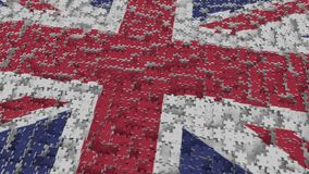 Flag of the United Kingdom being made with jigsaw puzzle pieces. British problem solution conceptual 3D rendering. Flag made of puzzle pieces, conceptual 3D stock illustration