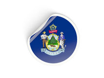 Flag of maine, US state round sticker Stock Image