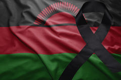 Flag of malawi with black mourning ribbon Stock Photo