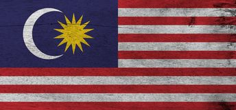 Flag of Malaysia on wooden plate background. Grunge Malaysian flag texture. stock photo