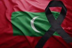 Flag of maldives with black mourning ribbon. Waving national flag of maldives with black mourning ribbon Royalty Free Stock Photos