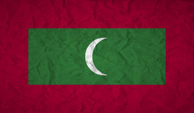 Flag of Maldives with the effect of crumpled paper and grunge Stock Photos