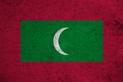Flag Maldives. Maldives flag on an old grunge background Royalty Free Stock Photo