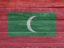 Flag of Maldives on wooden wall background. Grunge Maldives flag texture. Flag of Maldives on wooden wall background. Grunge Maldives flag texture, green with stock photo