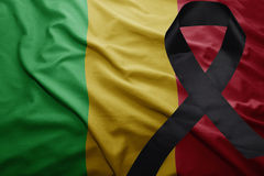 Flag of mali with black mourning ribbon Stock Images