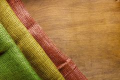 Flag of Mali. From rough fabric on a wooden surface Royalty Free Stock Image