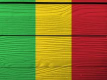 Flag of Mali on wooden wall background. Grunge Malian flag texture. Flag of Mali on wooden wall background. Grunge Malian flag texture, A vertical tricolor of stock images