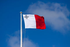 Flag of Malta. Against blue sky during wind Royalty Free Stock Images