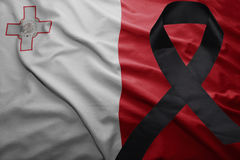 Flag of malta with black mourning ribbon. Waving national flag of malta with black mourning ribbon Royalty Free Stock Photos