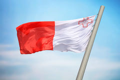 Flag of Malta. The Maltese flag against the background of the blue sky Royalty Free Stock Image