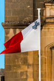 Flag of Malta. Maltese flag on the blue sky waving in the wind Royalty Free Stock Photography