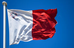 Flag of Malta. Maltese flag on the blue sky waving in the wind, Valletta, Malta Royalty Free Stock Photos