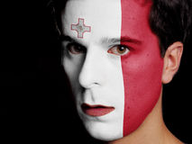 Flag of Malta. Painted on a Face of a Young Man Royalty Free Stock Image
