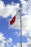 Flag of Malta on the Pole. Waving in the wind Stock Images