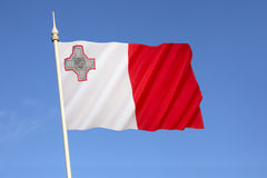 Flag of Malta. A representation of the George Cross, awarded to Malta by Britains King George VI in 1942, is in the top left corner of the flag Royalty Free Stock Image
