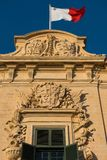 Flag of Malta on top of the Auberge de Castille Royalty Free Stock Photos
