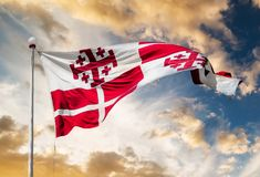 Flag on Malta waving. Sovereign Military Order of Malta and Jerusalem Cross Flag waving against sunset sky Royalty Free Stock Images
