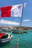 Flag of Malta. Waving in the wind in Marsaxlokk, Malta Royalty Free Stock Photos