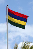 The flag of Mauritius. Against a blue sky in Mauritius, Africa royalty free stock image