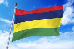 Flag of Mauritius developing against a clear blue sky. On a sunny day Royalty Free Stock Image
