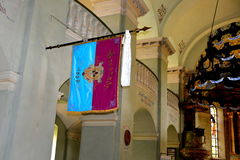 Flag in the medieval fortified church in Cristian, Transylvania. Cristian (Neustadt im Burzenland German) is a village in the county of Brasov, Transylvania Royalty Free Stock Image