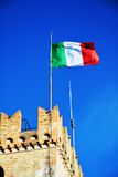 Flag and medieval walls, Castello, Conegliano Veneto, Treviso, Italy. Flag in the wind on the medieval walls, at Castello, in Conegliano Veneto, Treviso, Italy Stock Photography