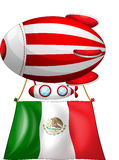 The flag of Mexico attached to a floating balloon Stock Image