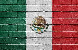 Flag of Mexico on brick wall Stock Image