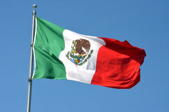 Flag of Mexico. Mexican flag waving against clear blue sky royalty free stock images