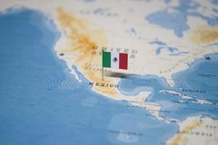 The Flag of mexico in the world map stock photos
