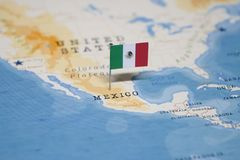 The Flag of mexico in the world map royalty free stock images