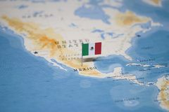 The Flag of mexico in the world map stock photography
