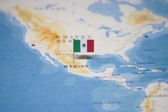 The Flag of mexico in the world map royalty free stock image